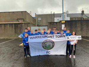 u12 players holding WTFC flag