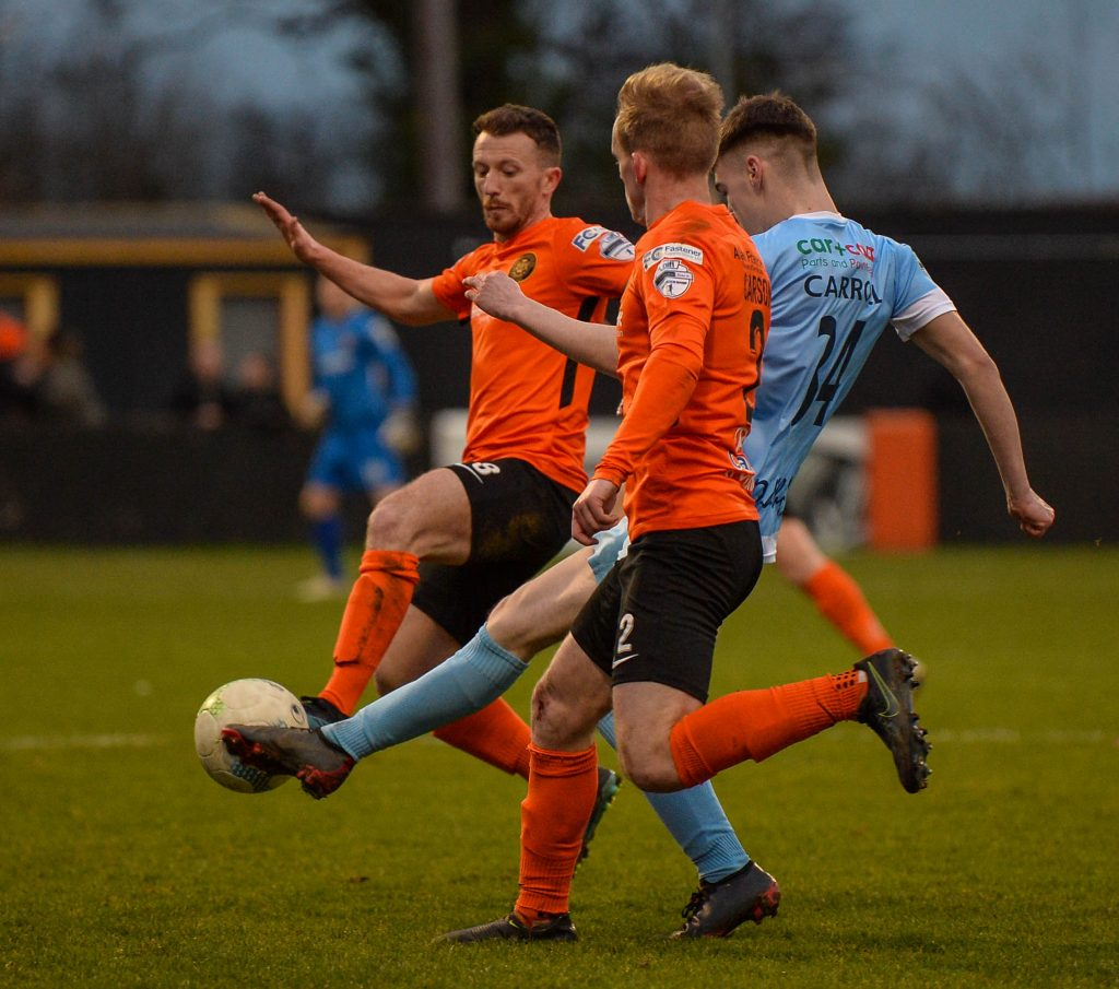 Adam Carroll in action against Carrick Rangers.